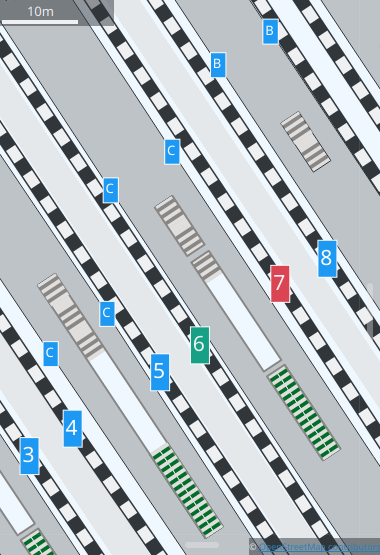 Map showing colored labels for the arrival and departure platforms at a train station.